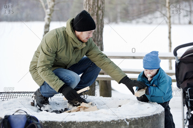 Father with son preparing campfire