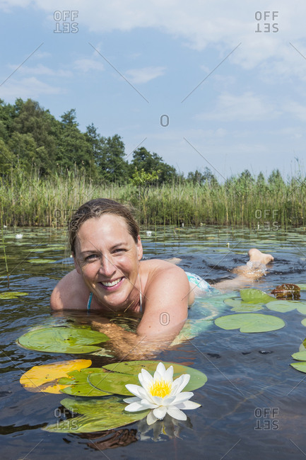 Smiling woman in lake