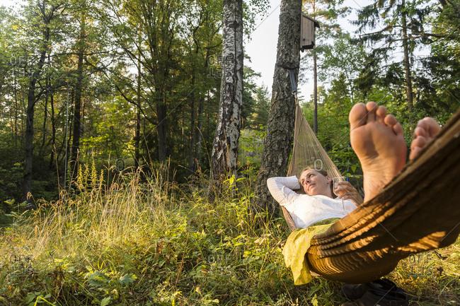 Woman relaxing on hammock