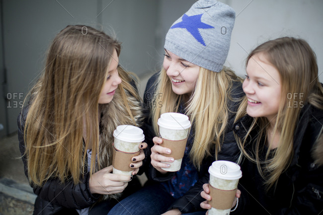 Smiling girls having drink