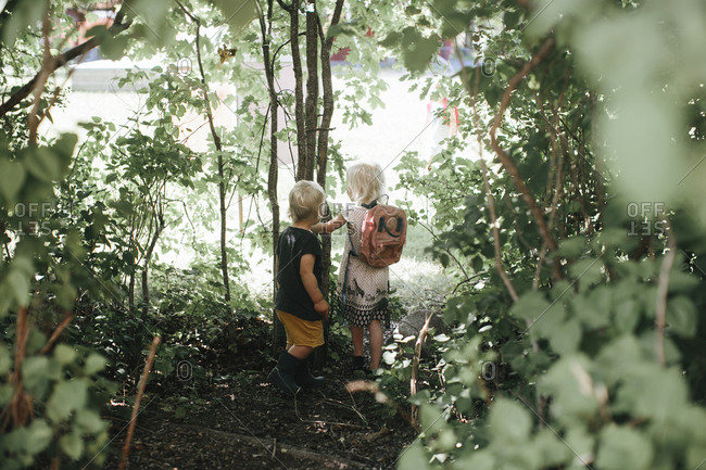 Children walking through woods