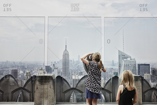 Girls looking at skyscrapers