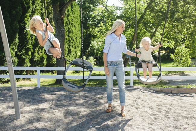 Mother with daughters on playground