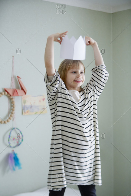 Smiling girl with paper crown