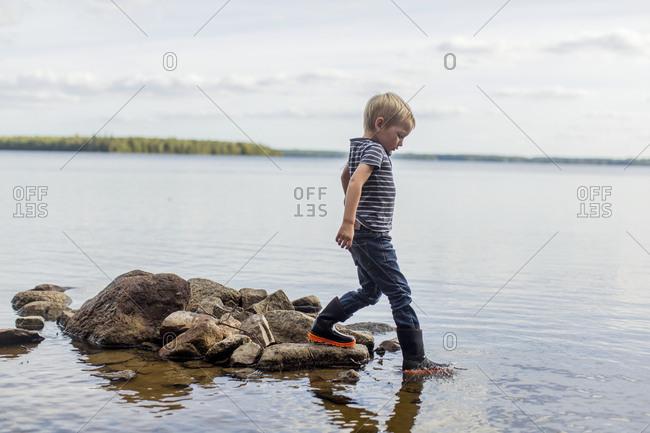 Boy walking in water