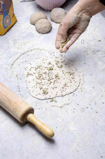 Woman preparing homemade crisp bread
