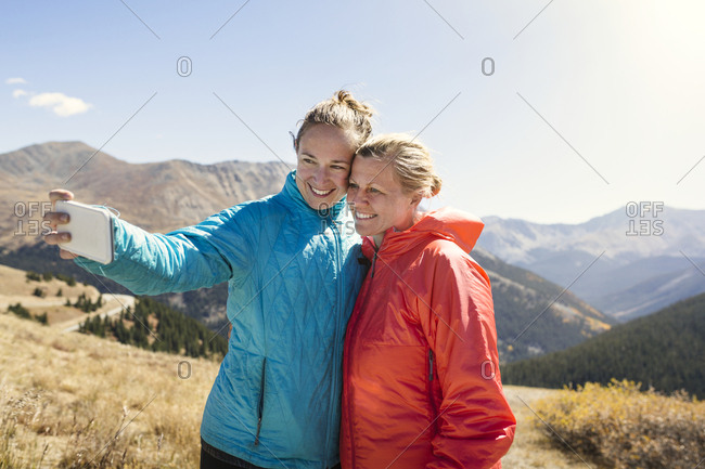 Young women taking selfie in mountains
