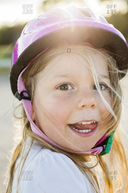 Portrait of blond girl wearing helmet