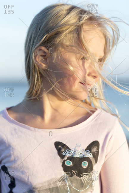 Portrait of blond girl on beach