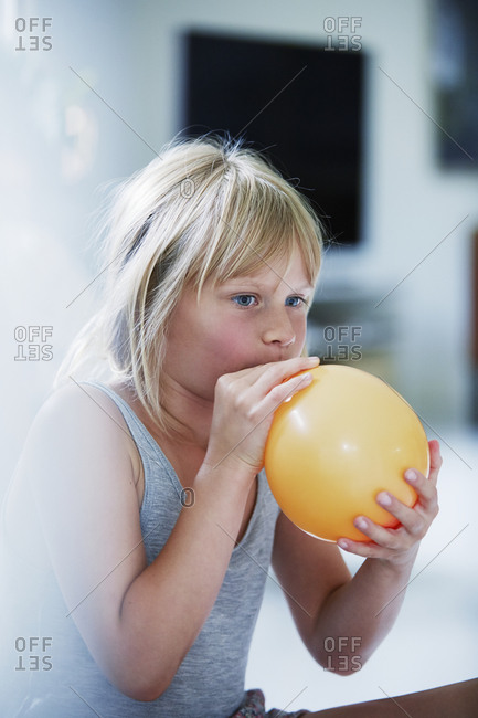 Girl blowing balloon