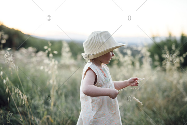 Small girl playing in field
