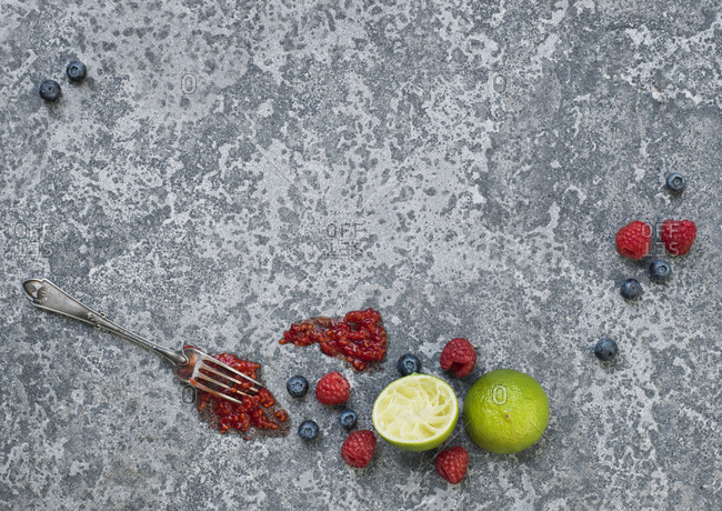 Lime and berries on stone table