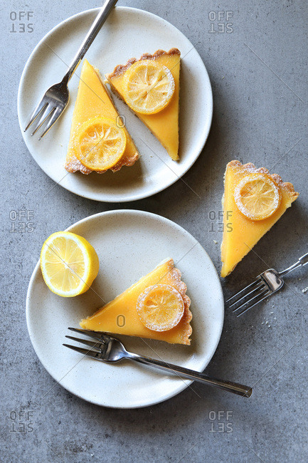 Lemon tart slices served on white plates