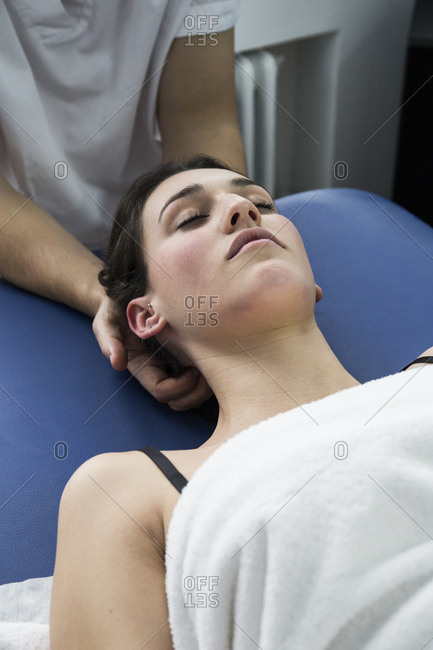 Patient receiving a neck massage from a physiotherapist in a clinic