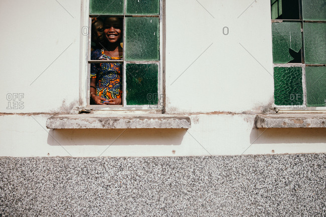 January 22, 2015 - Ghana, Africa: Child looking out of window of church
