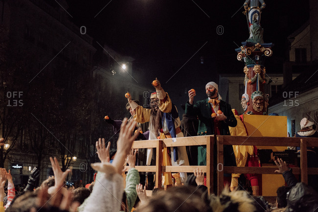 Lucerne, Switzerland - February 25, 2017: Characters riding on a float holding oranges at the Lucerne Carnival Parade
