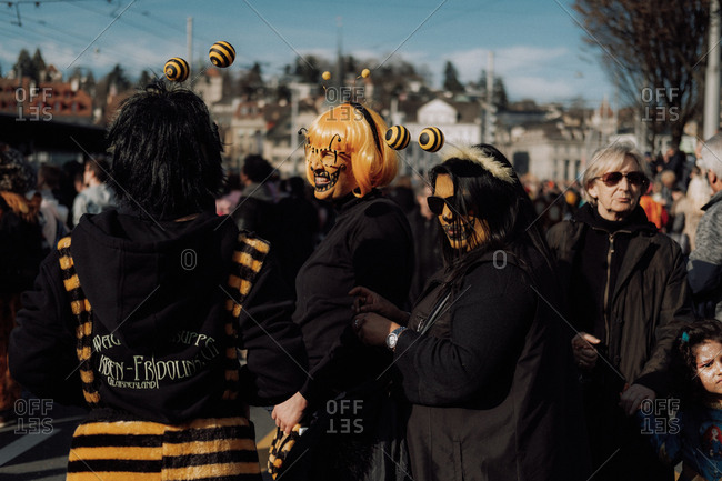 Lucerne, Switzerland - February 25, 2017: Women dressed as bumblebees at the Lucerne Carnival Parade