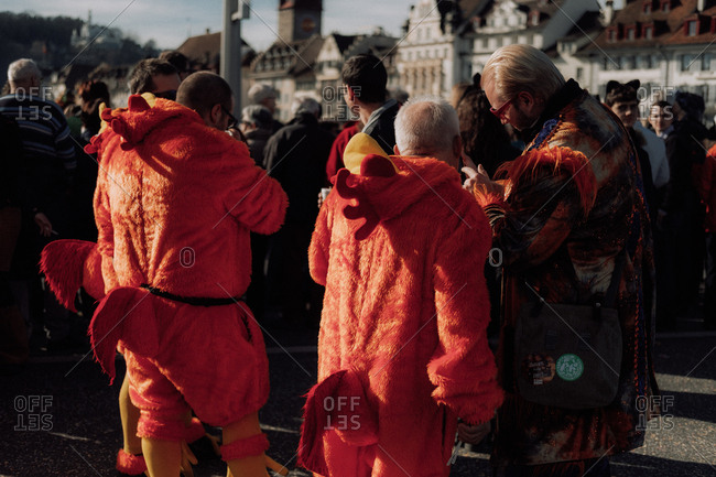 Lucerne, Switzerland - February 25, 2017: Men dressed as red roosters at the Lucerne Carnival Parade