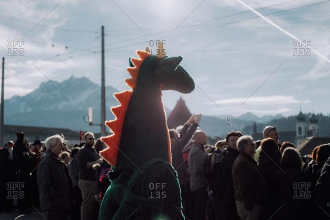 Lucerne, Switzerland - February 25, 2017: Lucerne Carnival Parade onlooker dressed as a dinosaur