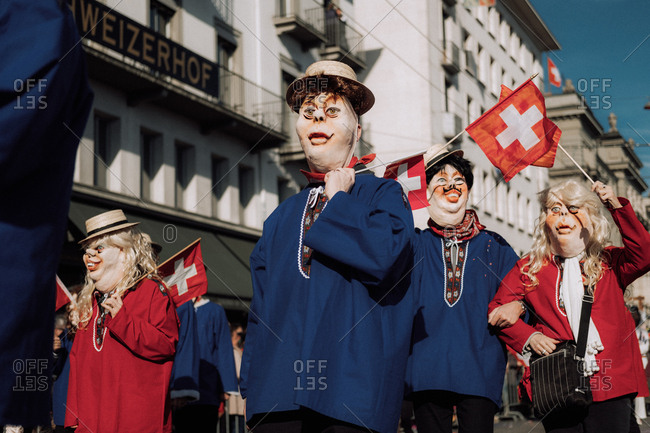 Lucerne, Switzerland - February 25, 2017: People wearing costumes marching at the Lucerne Carnival Parade