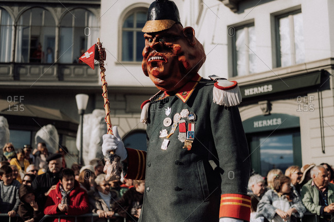 Lucerne, Switzerland - February 25, 2017: Person dressed in costume marching in the Lucerne Carnival Parade