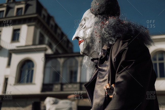 Lucerne, Switzerland - February 25, 2017: Side view of man dressed in scary costume at the Lucerne Carnival Parade