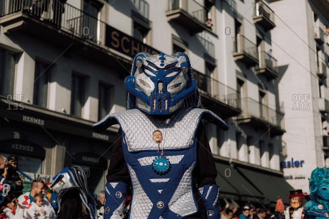 Lucerne, Switzerland - February 25, 2017: Person in silver and blue costume at the Lucerne Carnival Parade