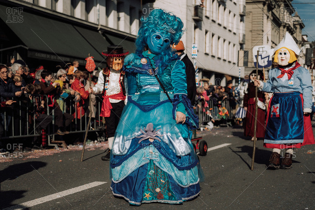 Lucerne, Switzerland - February 25, 2017: Woman in blue costume at the Lucerne Carnival Parade