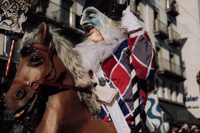 Lucerne, Switzerland - February 25, 2017: Man in costume with horse at the Lucerne Carnival Parade