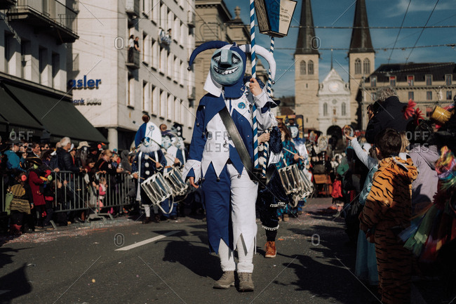 Lucerne, Switzerland - February 25, 2017: Person blue jester costume at the Lucerne Carnival Parade