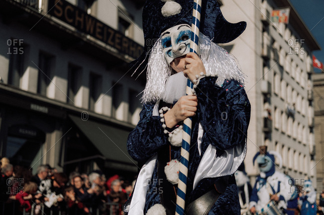 Lucerne, Switzerland - February 25, 2017: Person wearing blue jester costume at the Lucerne Carnival Parade