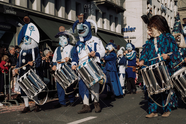 Lucerne, Switzerland - February 25, 2017: Marching band in blue costumes at the Lucerne Carnival Parade