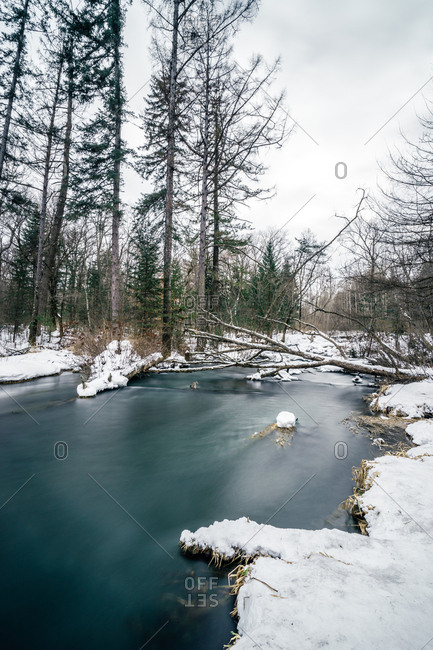 Snowy riverbanks in nature reserve in Jilin, China