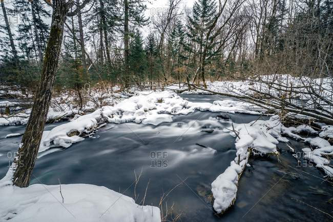 Swiftly moving stream in winter, Jilin, China