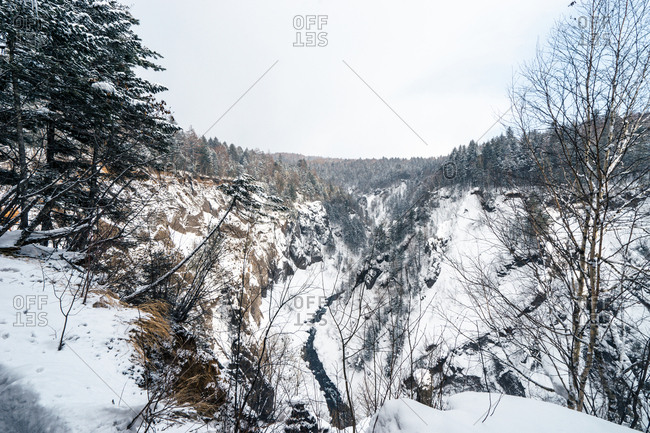 Overlooking snowy valley with river in Jilin, China