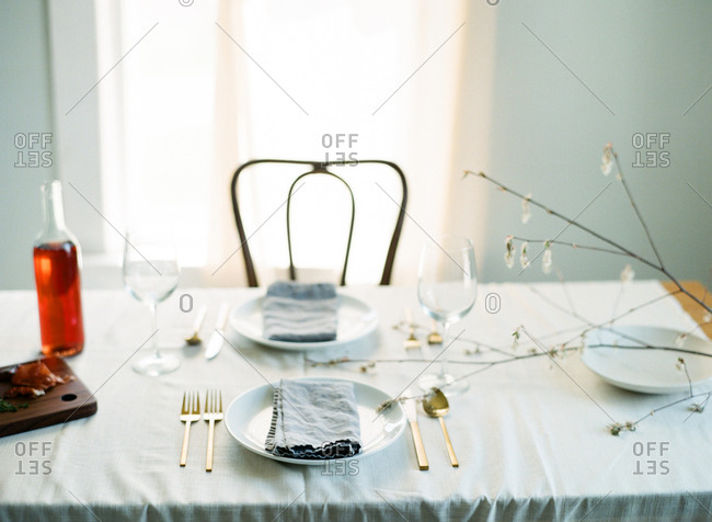 Set table with wine bottle