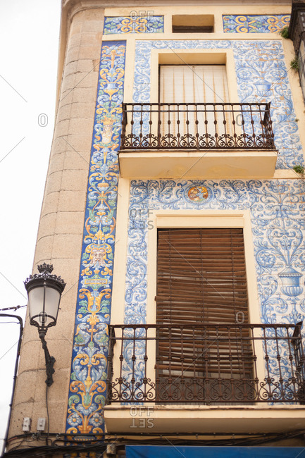 Building with ornate tile fa�ade in Caceres, Spain