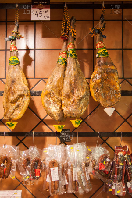 Extremadura, Spain - May 24, 2016: Cured meat hanging in a shop
