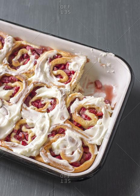 Strawberry sweet rolls in a baking pan