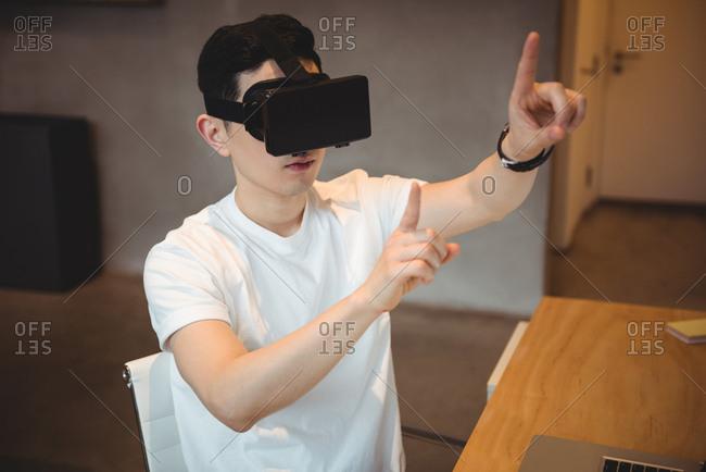 Business executive using virtual reality headset