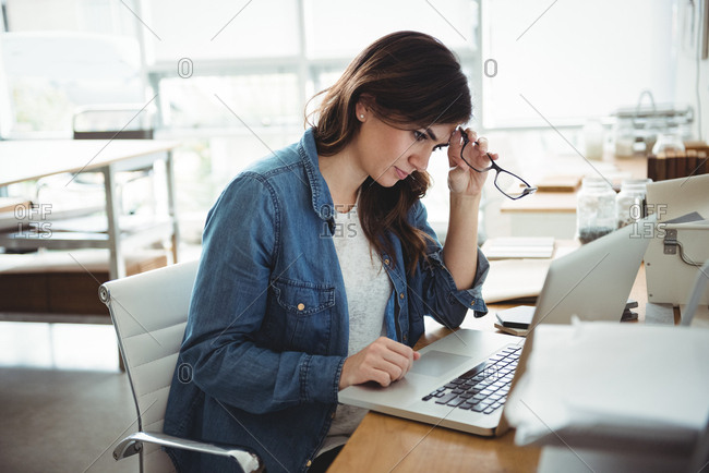 Thoughtful business executive using laptop