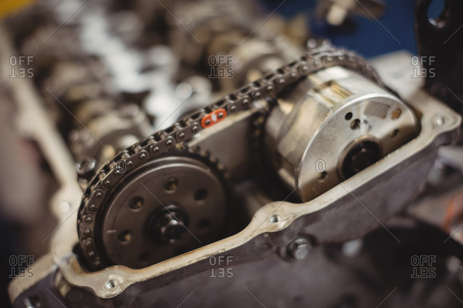 Close-up of car engine chain and gears