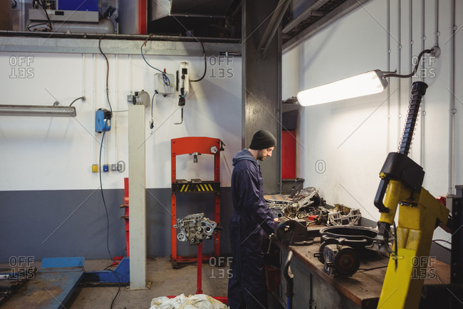 Mechanic checking a car parts