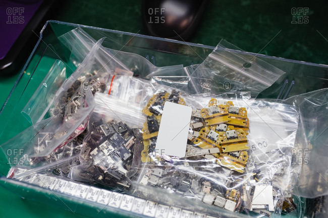 Various electronic components in boxes