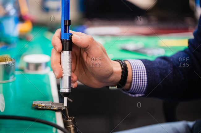 Man using solder remover