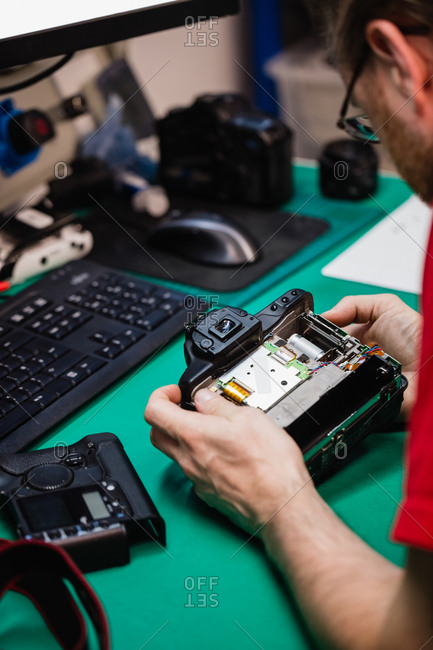 Man repairing digital camera