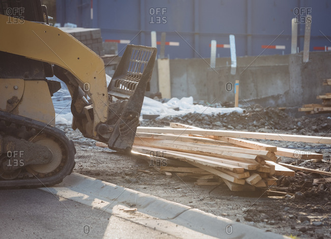 Bulldozer unloading timber