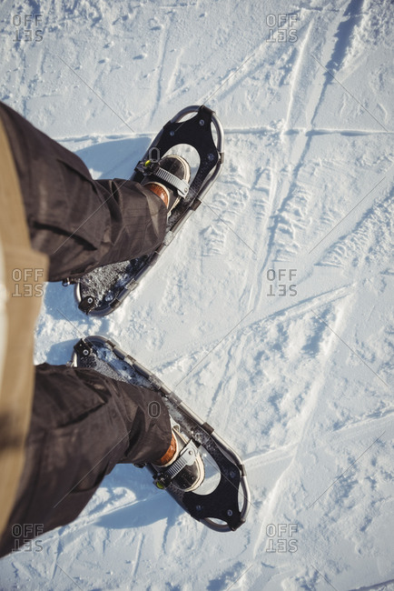 Close up of skier shoes on snowy landscape