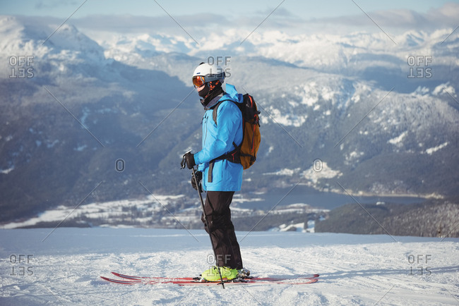 Skier skiing on snowy mountains