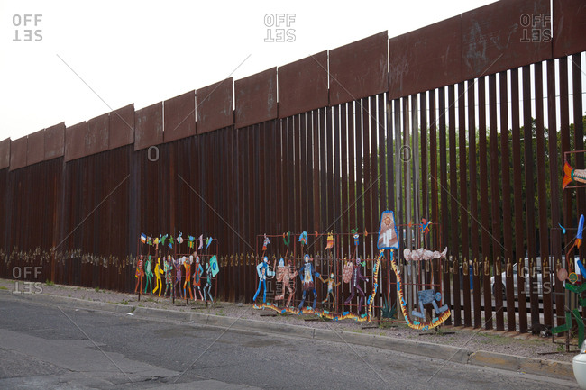 Sonora, Mexico - October 9, 2008: Art on the Mexican border wall